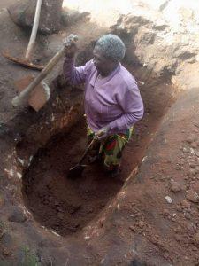 women digging grave